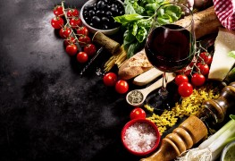Tasty fresh appetizing italian food ingredients on dark background. Ready to cook. Home Italian Healthy Food Cooking Concept.